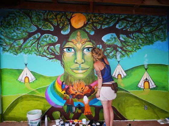 artist nek kuc painting a mural